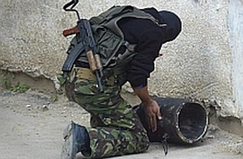 terrorist with explosive (photo credit: AP [file])