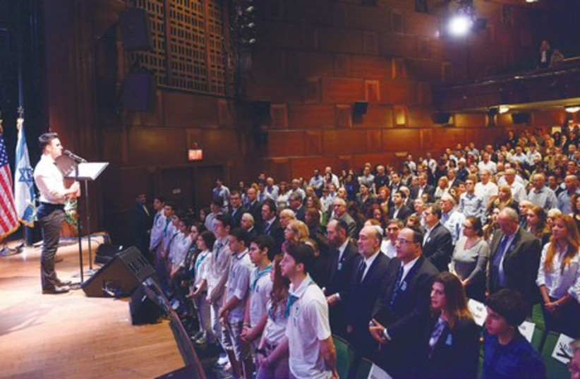 CROWD STANDS during the Remembrance Day memorial service in New York (photo credit: ISRAEL CONSULATE)