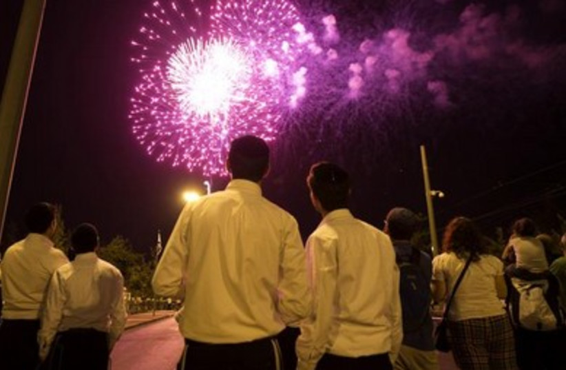 Revelers celebrate Independence Day with a party in Jerusalem, May 5, 2014. (photo credit: REUTERS)