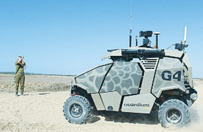 THE GUARDIUM, the UVG already in use by the Southern Command, drives along the Gaza border. (photo credit: IDF)