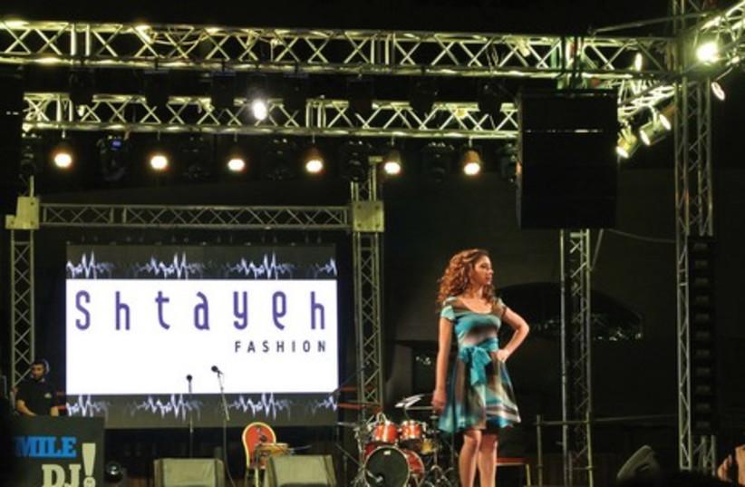 Models and dancers traverse the stage at Palestine Fashion Week (photo credit: SETH J. FRANTZMAN)