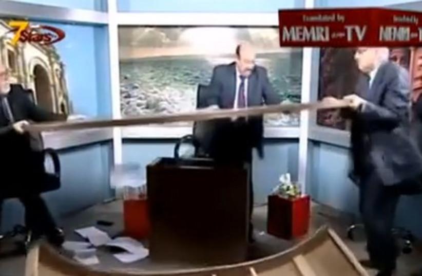 Jordanian commentators tear apart studio (photo credit: YOUTUBE SCREENSHOT)