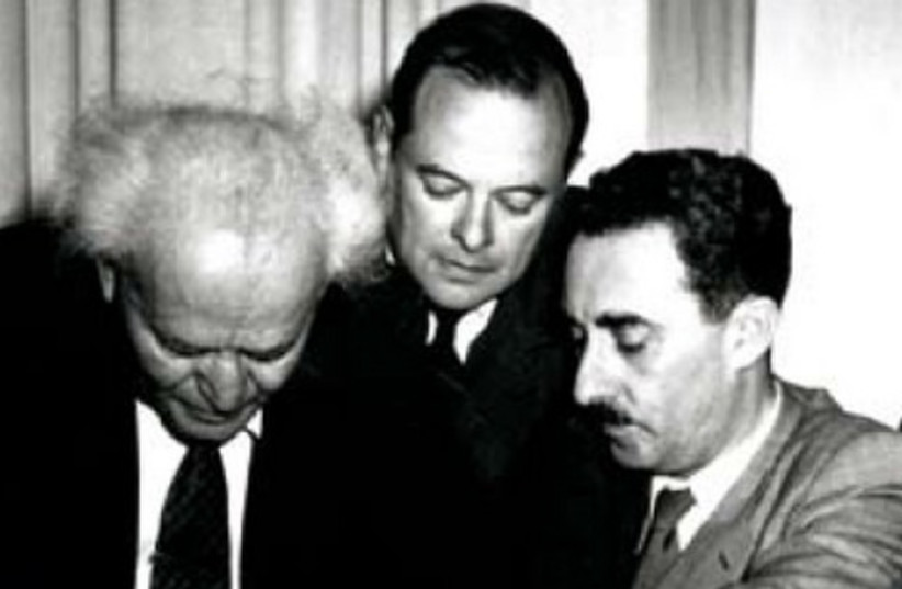 David Ben-Gurion signs the Declaration of Independence on May 14, 1948. Moshe Sharett is on the right  (photo credit: JERUSALEM POST ARCHIVE)