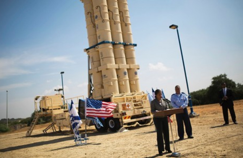 US National Security Adviser Susan Rice addresses the media as she stands in front of a launcher of an Arrow II ballistic missile interceptor, at the IAF Palmahim base. (photo credit: REUTERS)