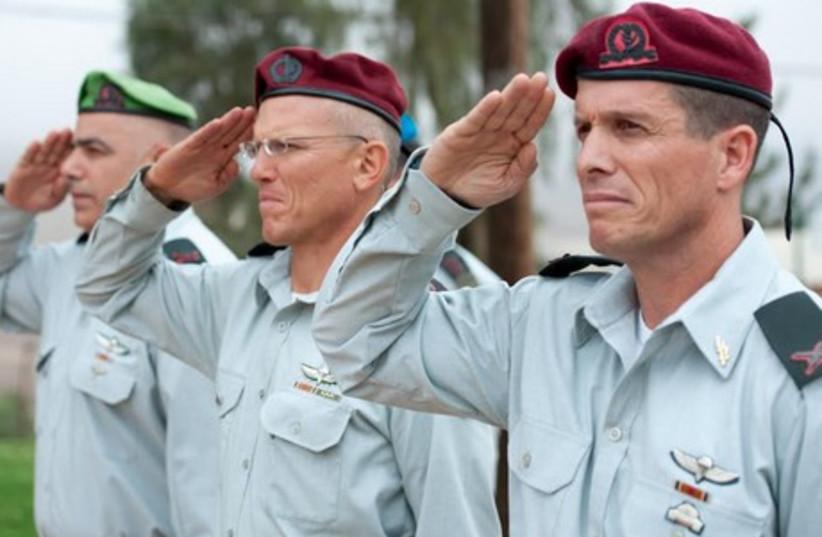 From left to right: Brig.-Gen. Moti Baruch, Maj.-Gen. Alon Nitzan, and Brig.-Gen. Nadav Padan. (photo credit: IDF)