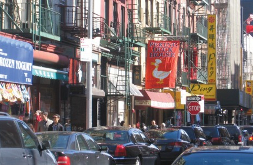 New York City's Chinatown during rushhour traffic. (photo credit: BEN G. FRANK)