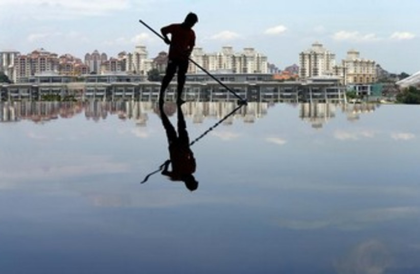 Reflection in water (photo credit: REUTERS)