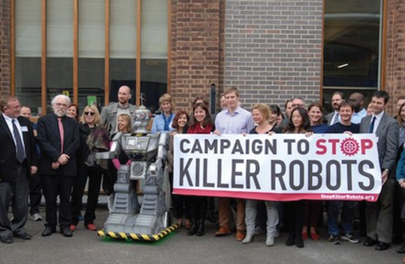 Protesters against the use of killer robots jump-start their campaign during a demonstration outside the Frontline media club in London on April 23. (photo credit: STOPKILLERROBOTS.ORG)