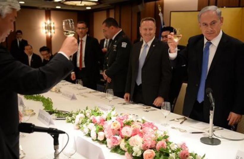PM Netanyahu meets Japanese parliamentarians in Tokyo, May 12 (photo credit: KOBI GIDEON/GPO)