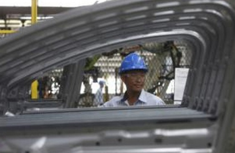 Thai worker (photo credit: REUTERS)