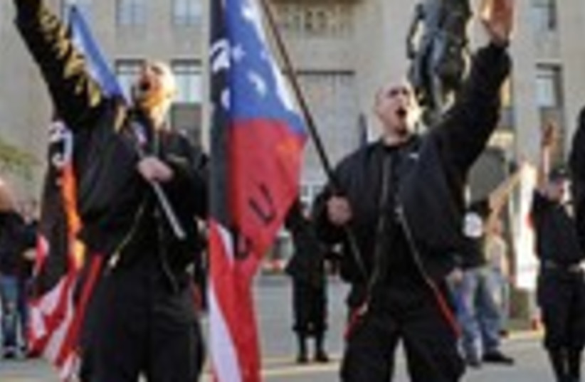 Members of the US National Socialist Movement salute during a neo-Nazi rally in Kansas City on the 75th anniversary of the Kristallnacht attack on Jews in Germany (photo credit: DAVE KAUP / REUTERS)