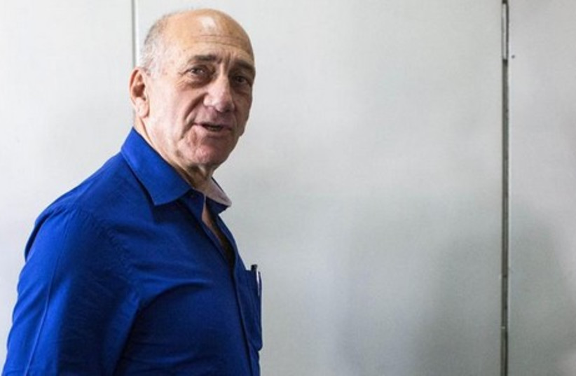 Former Israeli Prime Minister Ehud Olmert leaves Tel Aviv District Court May 13, 2014. (photo credit: REUTERS)