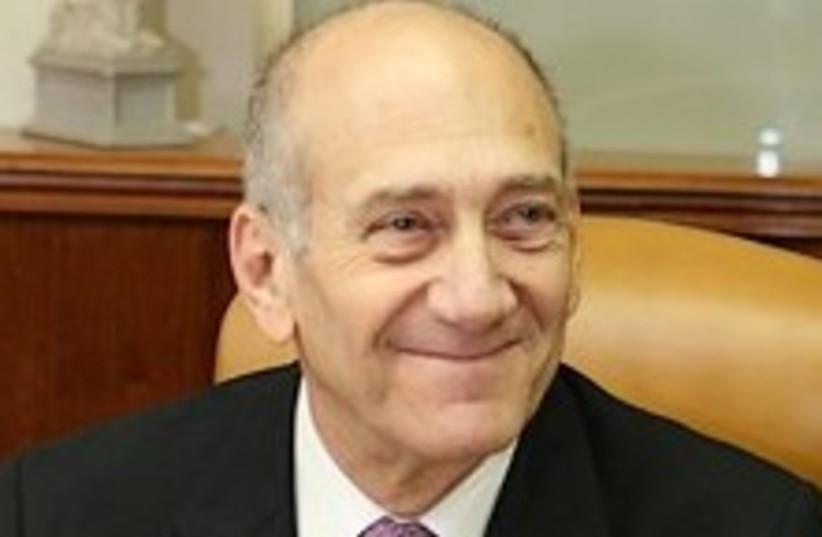 Olmert loves life 224.88 (photo credit: Ariel Jerozolimski)