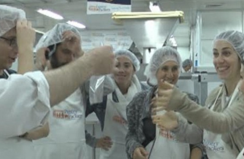 Pantry Packers volunteer packing plant of Colel Chabad in Jerusalem. (photo credit: Courtesy)
