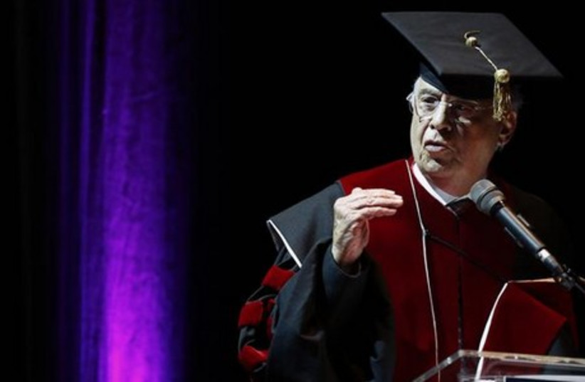 Former Brazilian president Fernando Henrique Cardoso gestures as he gives a speech after receiving an honorary doctorate at Tel Aviv University. (photo credit: REUTERS)