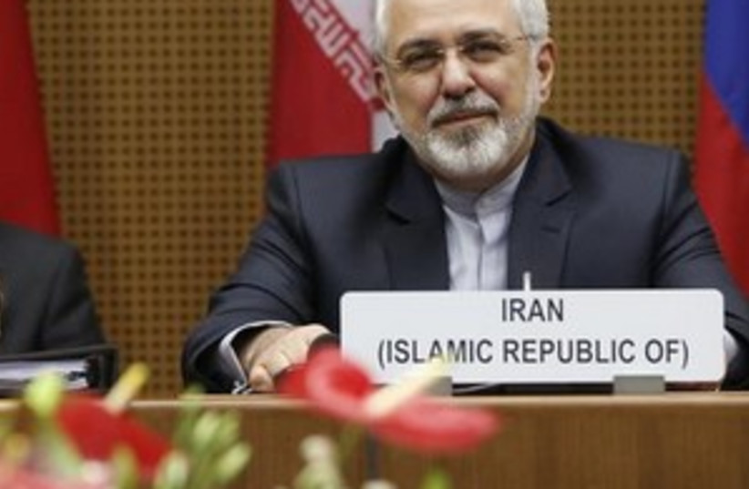 EU foreign policy chief Catherine Ashton (L) and Iranian Foreign Minister Mohammad Javad Zarif at talks in Vienna May 14, 2014. (photo credit: REUTERS)