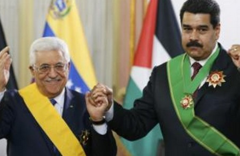 Venezuela's President Nicolas Maduro (R) and Palestinian President Mahmoud Abbas  (photo credit: REUTERS)