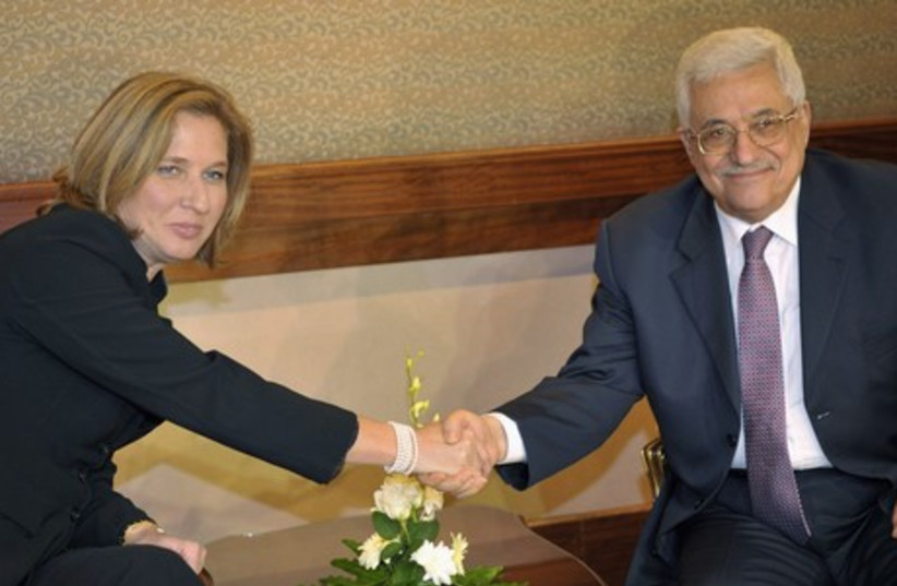 Justice Minister Tzipi Livni (L) and Palestinian Authority President Mahmoud Abbas. (photo credit: REUTERS)