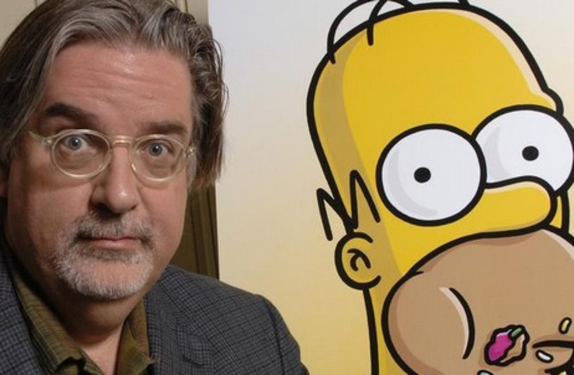 """Matt Groening, creator of """"The Simpsons"""", poses for photographs while promoting """"The Simpsons Movie"""" in 2007. (photo credit: REUTERS)"""