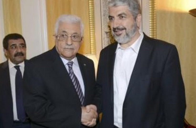 Palestinian President Mahmoud Abbas (L) shakes hands with Hamas chief Khaled Meshaal in Doha May 5, 2014.  (photo credit: REUTERS)