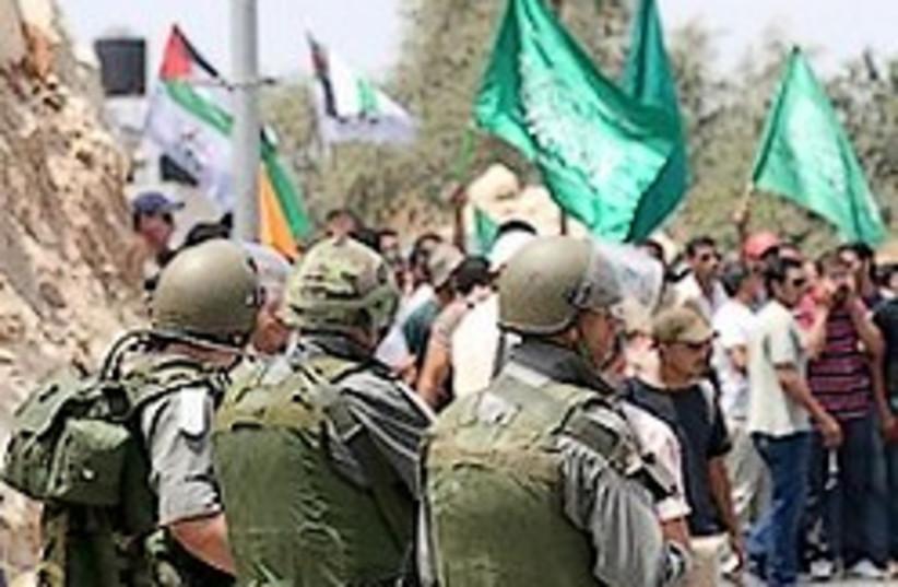 Nilin protest Border police 248.88 (photo credit: Ariel Jerozolimksi )