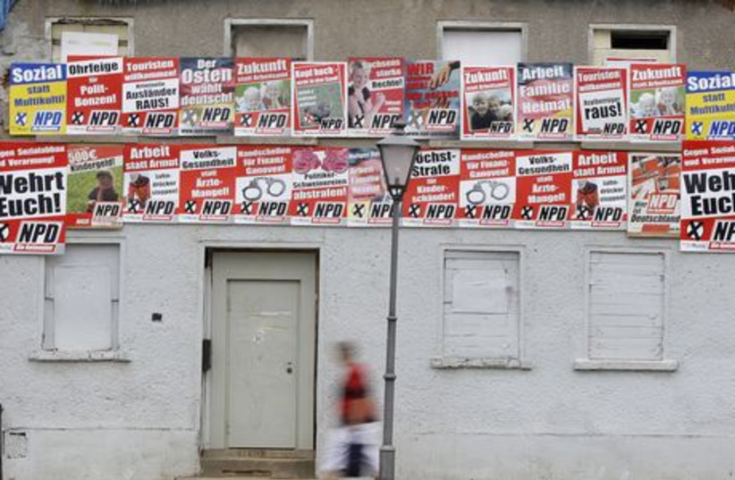 Election banners of the far-right German National Democratic Party (NPD) are pictured in village of Zwenkau (photo credit: REUTERS)