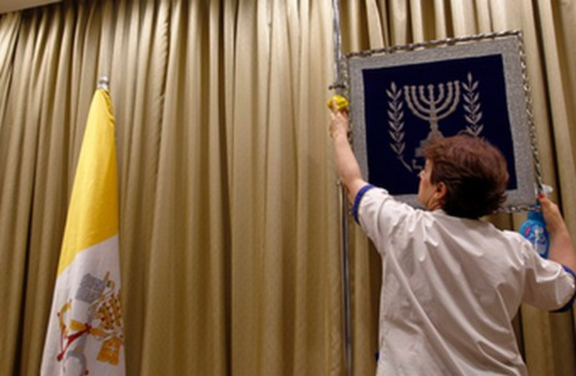 Worker at President's Residence prepares for Pope's visit (photo credit: REUTERS)
