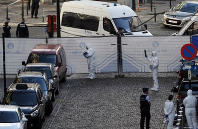 Police personnel are seen at the site of a shooting in central Brussels, May 24, 2014. (photo credit: REUTERS)