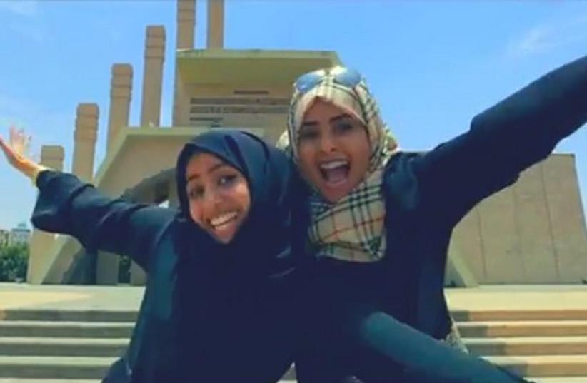 "Two girls dancing in ""The Official Happy Yemen video""  (photo credit: YOUTUBE SCREENSHOT)"