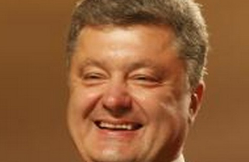 Ukrainian businessman, politician and presidential candidate Petro Poroshenko smiles as he speaks to supporters at his election headquarters in Kiev May 25, 2014. (photo credit: REUTERS)