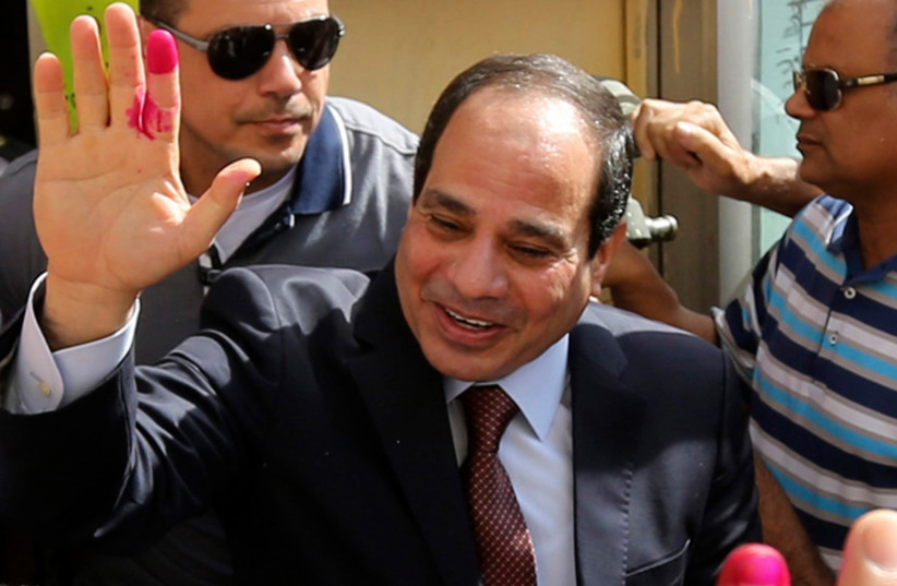 Abdel Fattah al-Sisi gestures after casting his ballot in Cairo, May 26, 2014 (photo credit: REUTERS)