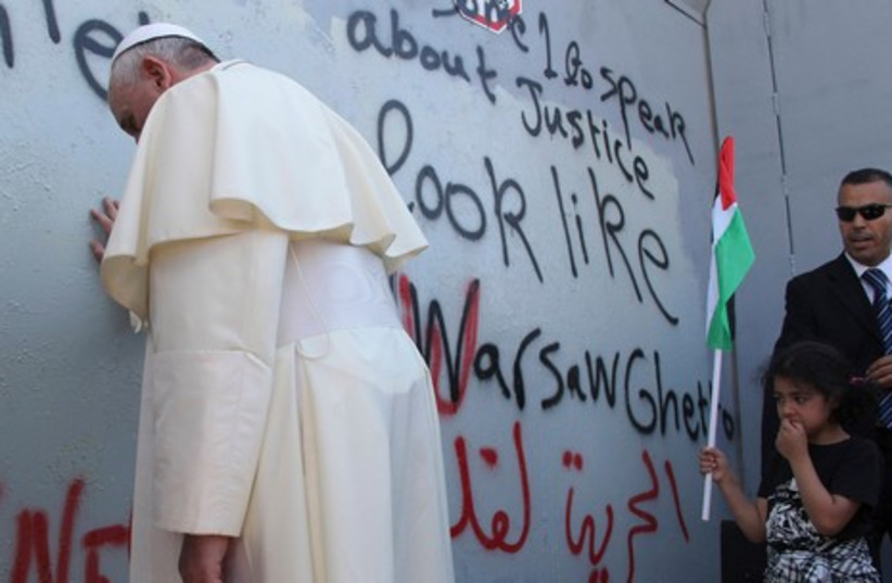 Pope Francis at the West Bank separation barrier (photo credit: REUTERS)