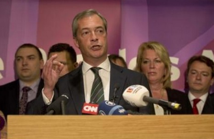 UK Independence Party leader Nigel Farage delivers a speech in London after sweeping to victory in the European elections. (photo credit: REUTERS)