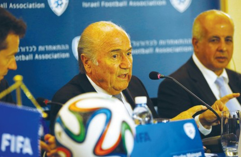 FIFA President Sepp Blatter (center) speaks during the news conference that was held May 27 in Jerusalem. (photo credit: REUTERS)