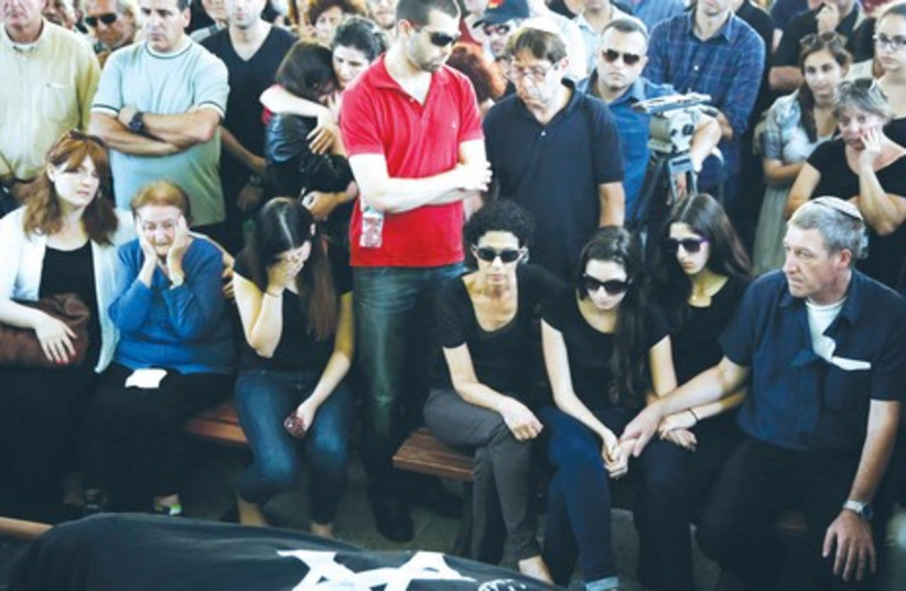 Mourners attend the funeral of Mira and Emmanuel Riva in Tel Aviv May 27. (photo credit: FINBARR O'REILLY / REUTERS)