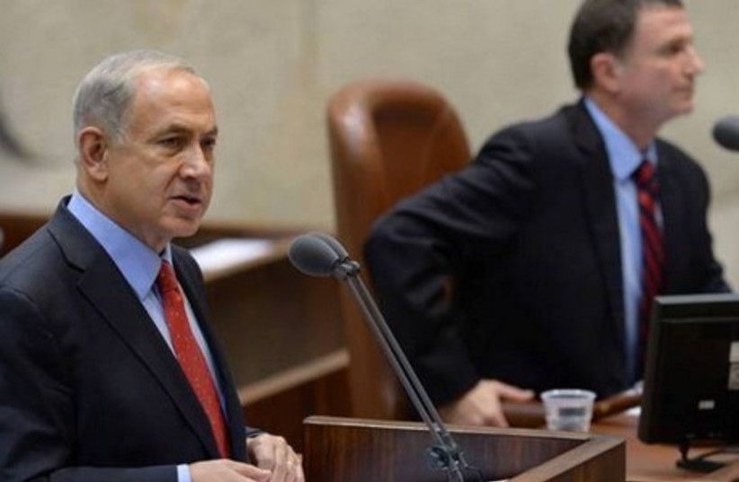 Prime Minister Benjamin Netanyahu addresses the Knesset. (photo credit: GPO)