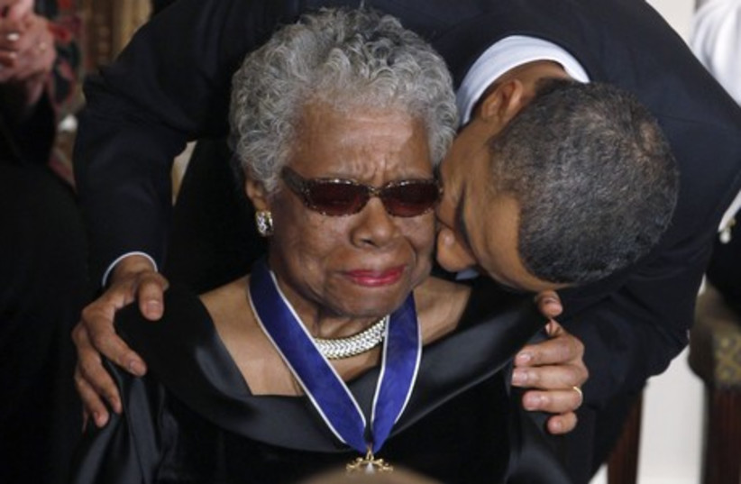 Maya Angelou receives a Medal of Freedom from US President Barack Obama at the White House in Washington, February 15, 2011. (photo credit: REUTERS)