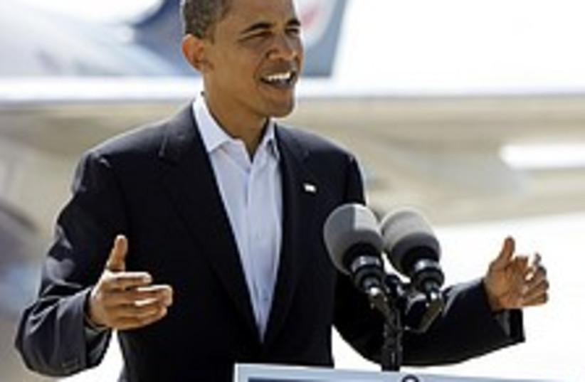 obama smile 224.88 (photo credit: AP)