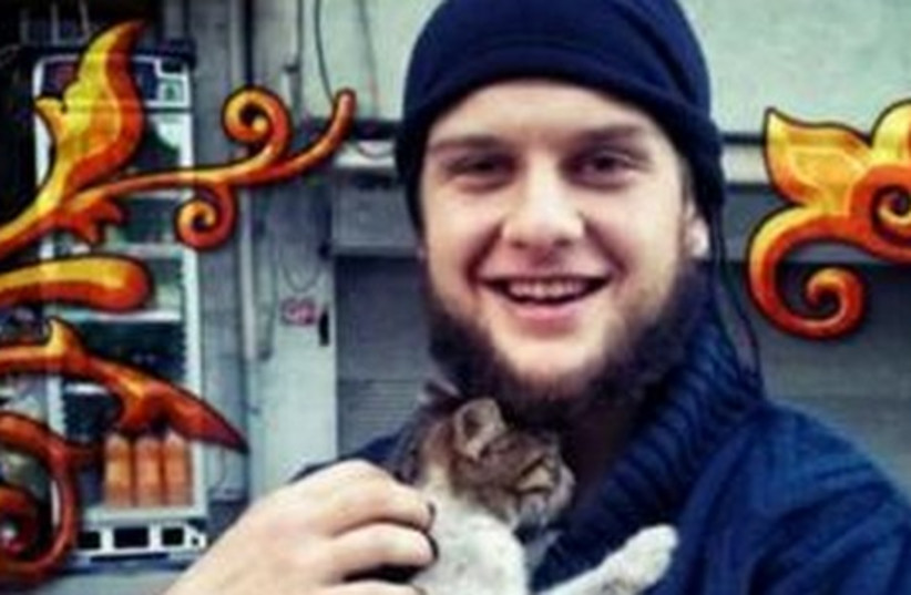 Twitter message included a picture of a man identified as Abu Hurayra holding a kitten, as well as pictures of the booby-trapped truck and an explosion. (photo credit: TWITTER)