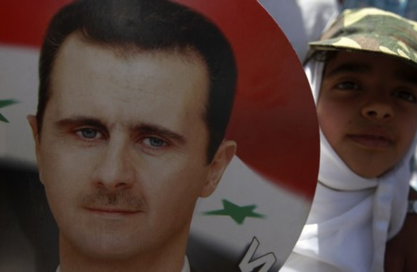 Syrian President  Bashar Assad faces new elections  (photo credit: REUTERS)