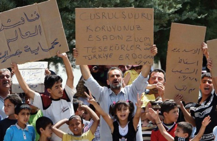 Syrians at a refugee camp in Turkey protest in 2011. (photo credit: REUTERS)