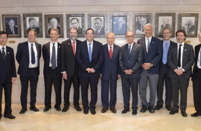 THE WOLF PRIZE: President Shimon Peres (sixth from left) and Education Minister Shai Piron (fifth from left) award the Wolf Prize to nine winners in the fields of science, medicine, agriculture, mathematics and the arts at the Knesset. (photo credit: Mark Neiman/GPO)
