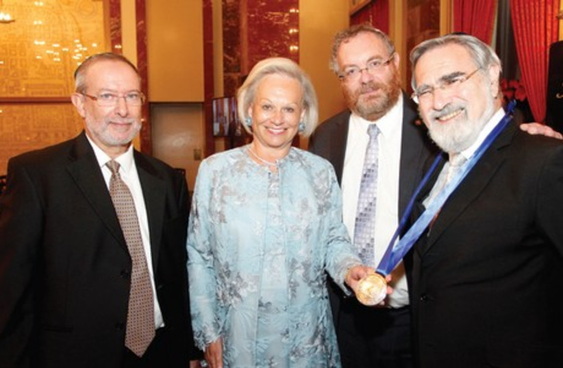 (From left to right) Prof. Joshua Schwartz, director, Ingeborg Rennert and Rabbi Prof. Daniel Hershkowitz, president of the university, bestow the Guardian of Zion Award upon Rabbi Lord Jonathan Sacks. (photo credit: YONI REIF)