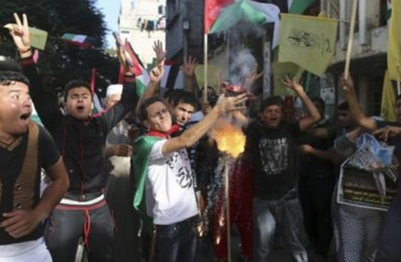 Palestinians celebrated the announcement of a Fatah-Hamas unity government, in the Gaza Strip June 2, 2014. (photo credit: REUTERS)
