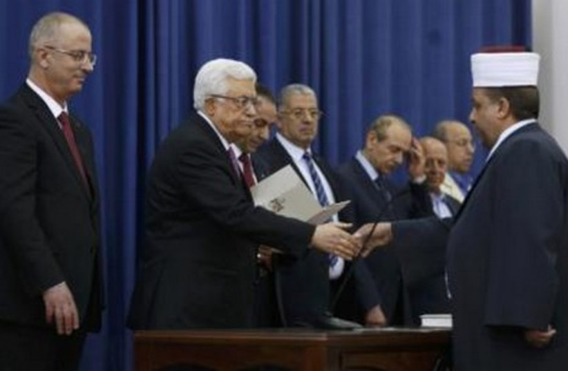 Sswearing-in ceremony of the Palestinian unity government, in Ramallah, June 2, 2014. (photo credit: REUTERS)