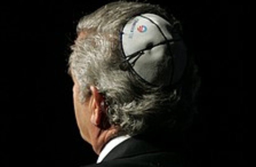 A man wears a kippah with the Obama campaign symbol (photo credit: AP)