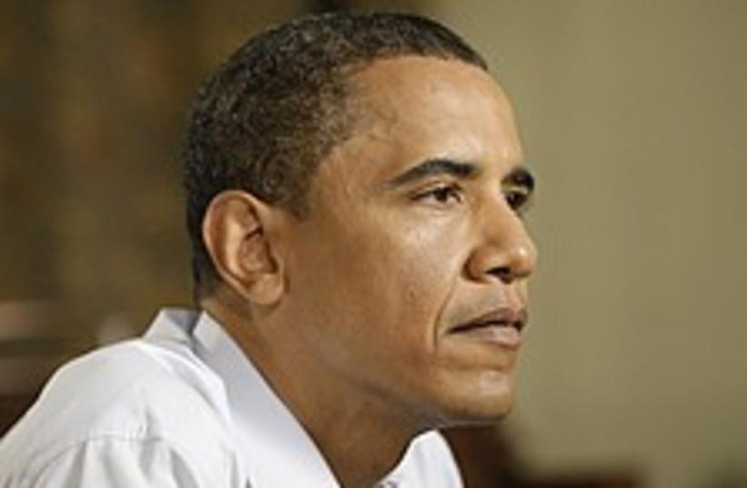 obama pensive 224 88 (photo credit: AP)