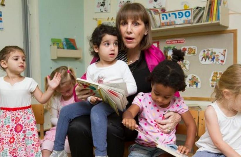 Livnat with children at daycare. (photo credit: ELI DASSA)