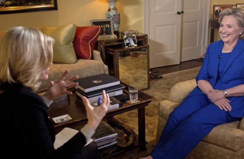 Former US secretary of state Hillary Clinton (R) talks with TV journalist Diane Sawyer. (photo credit: REUTERS)