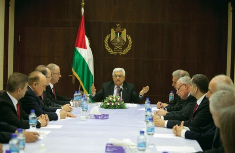 Palestinian President Abbas meets with ministers of the unity government in Ramallah (photo credit: REUTERS)